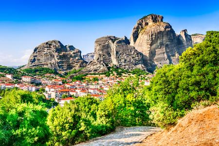 kalabaka: Kalabaka, Greece. City Kastraki (Kalambaka) with rocky mountains of Meteora, the landmark of six monasteries in Thessaly. Stock Photo