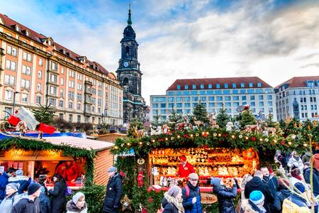 striezelmarkt: DRESDEN, SAXONY  GERMANY -  17 DECEMBER 2016: People visit Christmas Market  Striezelmarkt in Dresden, Germany. Christmas fair, European traditions.