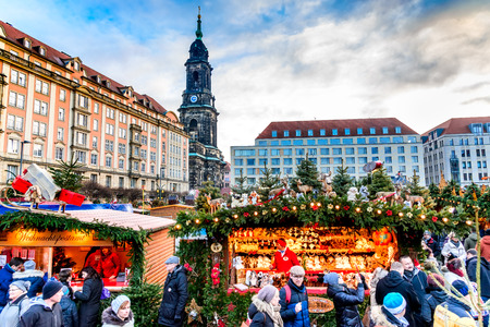 DRESDEN, SAXONY  GERMANY -  17 DECEMBER 2016: People visit Christmas Market  Striezelmarkt in Dresden, Germany. Christmas fair, European traditions.