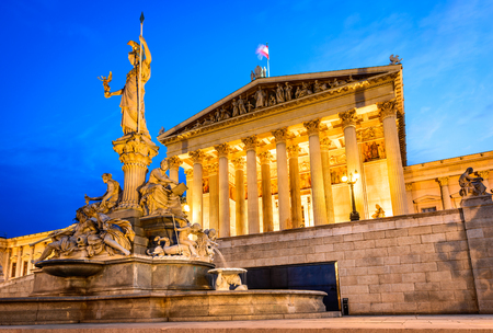Vienna, Austria. Austrian parliament building with Athena statue on the front in Wien on the twilight.