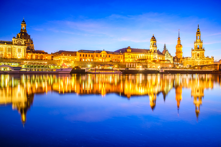 dresden: Dresden, Germany. Cathedral of the Holy Trinity or Hofkirche, Bruehls Terrace. Twilight sunset on Elbe river in Saxony.