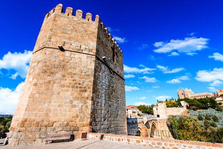 Toledo, Spain.  San Martin stone bridge across calm river. Popular tourist place in Europe.