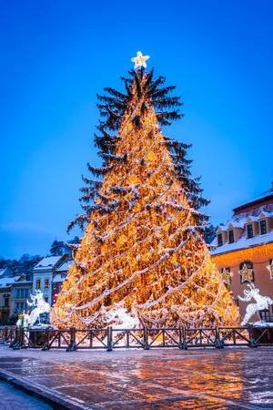 Brasov, Romania. Night image of Christmas Market in december 2014 in Council Square and Black Church landmark of Transylvania.