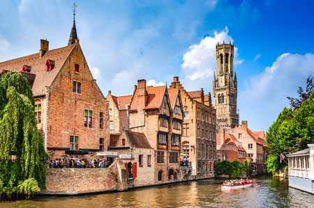 BRUGES, BELGIUM - 7 August 2014: Scenery with water canal in Bruges, Venice of the North, cityscape of Flanders, Belgium. Stock Photo
