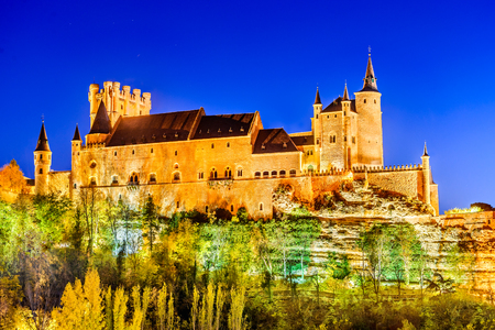 castille: Segovia, Spain. Autumn dusk view of Castle of Segovia, known as Alcazar and built in 12th century in Castile and Leon