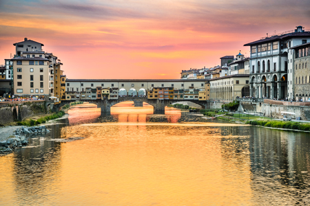 michelangelo: Florence, Tuscany - Ponte Vecchio,  medieval stone arch bridge over the Arno River, Renaissance architecture in Italy. Stock Photo