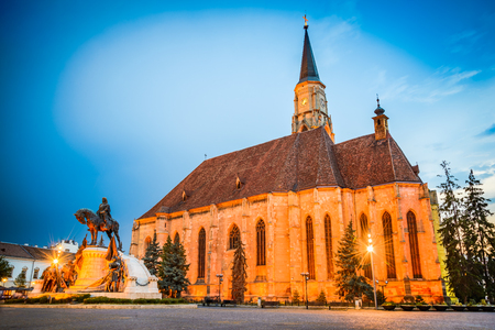 Cluj, Romania. Night scene with St. Michaels Church and Unirii Square in Cluj-Napoca, Transylvania.