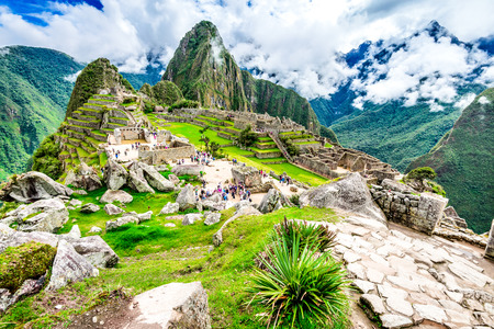 Machu Picchu in Peru with ruins of Inca Empire Huaynapicchu Mountain in Sacred Valley Cusco heritage of South America.