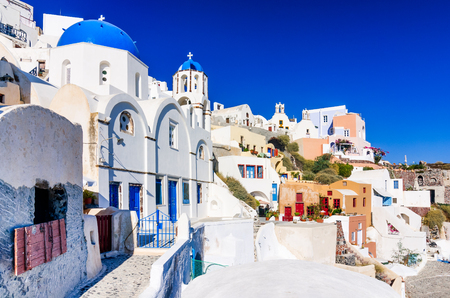 Santorini, Greece. Famous attraction of Oia village at sunset with windmill in Greek Islands, Aegean Sea. Stock Photo