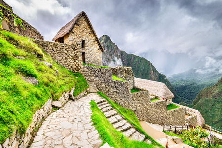 Machu Picchu, Peru - Houses and ruins of Inca Empire city, in Cusco region, amazing place of South America. Stock Photo