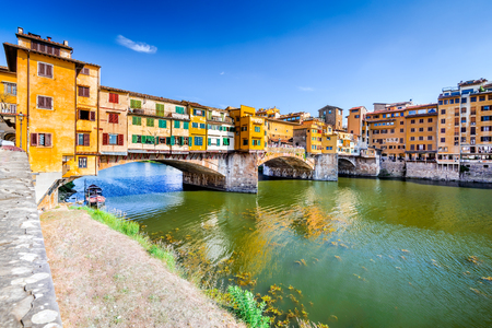 Florence, Tuscany - Ponte Vecchio, medieval bridge sunlighted over Arno River, Italy. Stock Photo