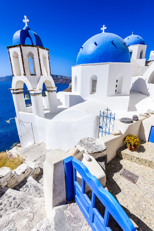Oia, Santorini - Greece. Famous attraction of white village with cobbled streets, Greek Cyclades Islands, Aegean Sea. Stock Photo
