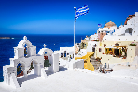 Santorini, Greece. Famous attraction of white Oia city, Greek Cyclades Islands, Aegean Sea. Stock Photo