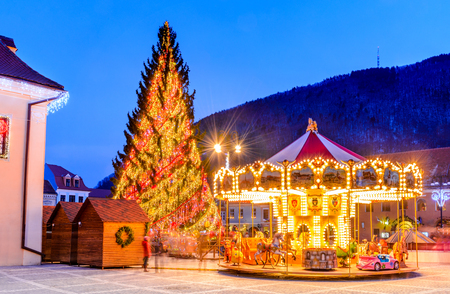 BRASOV, ROMANIA - 2 JANUARY 2016. Christmas Market Brasov, Romania, Transylvania. Main Square, with Xmas Tree and lights.