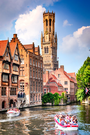 BRUGES, BELGIUM - 7 August 2014: Scenery with water canal in Bruges, Venice of the North, cityscape of Flanders, Belgium. Editorial