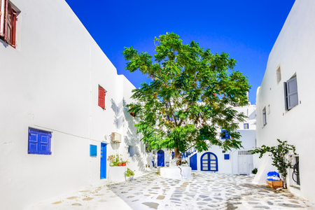 Mykonos, Greece. Whitewashed dotted alley in old city, Cyclades Greek Islands.