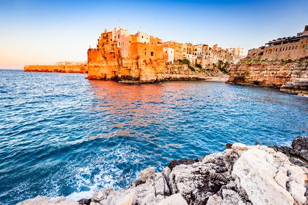 Polignano a Mare, Puglia, Italy. Sunset at Cala Paura gulf, province of Bari, Apulia, southern Italia on the Adriatic Sea