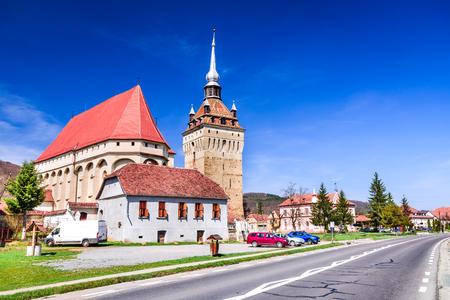 Saschiz, Romania - Medieval fortified church in Transylvania, saxon travel sight. Banco de Imagens