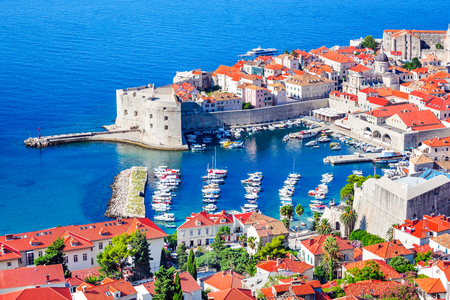 Dubrovnik, Croatia. Picturesque view on the old walled town, medieval Ragusa and Dalmatia at Adriatic Sea.