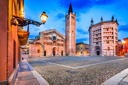 Parma, Italy - Piazza del Duomo with the Cathedral and Baptistery, built in 1059. Romanesque architecture in Emilia-Romagna. 스톡 콘텐츠