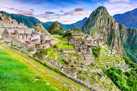 Machu Picchu in Peru - Ruins of Inca Empire city and Huaynapicchu Mountain in Sacred Valley, Cusco, South America. Banco de Imagens