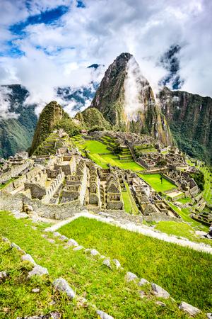 Machu Picchu in Peru - Ruins of Inca Empire city and Huaynapicchu Mountain in Sacred Valley, Cusco, South America. Stock Photo