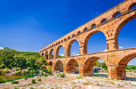 Pont du Gard three-tiered aqueduct was built in Roman times on the river Gardon. Provence summer day. Reklamní fotografie