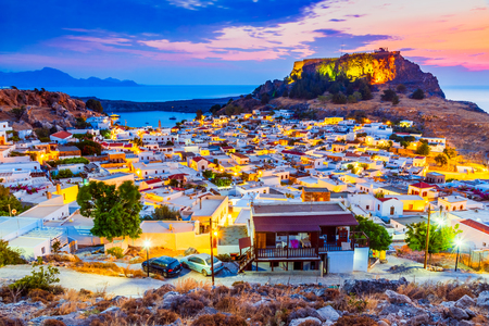 Rhodes, Greece. Lindos small whitewashed village and the Acropolis, scenery of Rhodos Island at Aegean Sea. Redakční