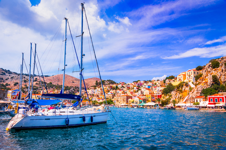 Symi, Greece. Colored houses village in Dodecanese islands, Rhodes.