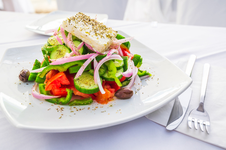 Greek salad with fresh vegetables, feta cheese and olives, Greece traditional cuisine. Reklamní fotografie