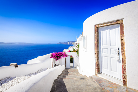 Oia, Santorini - Greece. Famous attraction of white village with cobbled streets, Greek Cyclades Islands, Aegean Sea. Reklamní fotografie