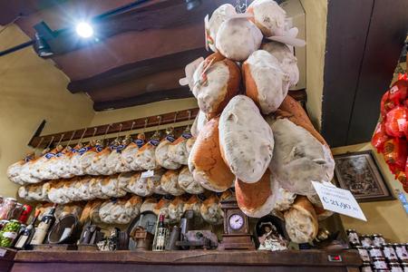 Bologna, Italy - June 2017: Local shop with traditional prosciutto and salami in Bologna. Emilia Romagna.