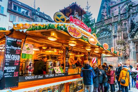 Strasbourg, France - December 2017: Marche de Noel, Place de la Cathedrale Christmas Market in Alsace. Redakční