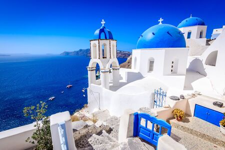 Oia, Santorini - Greece. Famous attraction of white village with cobbled streets, Greek Cyclades Islands, Aegean Sea.