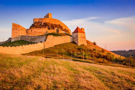 Rupea, Romania. Amazing sunset colors of Rupea fortress ruins in Brasov county Transylvania.