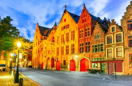 Bruges, Belgium. Twilight image with Hanseatic medieval square of Brugge, old Flanders gothic city in Belgium.