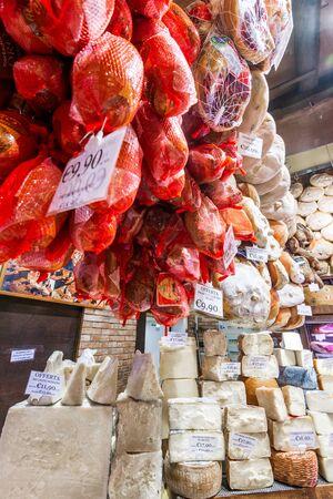 Bologna, Italy - June 2017: Local shop with traditional cheese, prosciutto and salami in Bologna. Emilia Romagna. 版權商用圖片