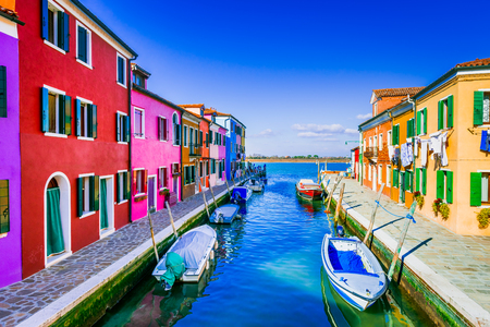 Burano, Venice. Image with colorful island and water canal from beautiful Veneto in Italy.