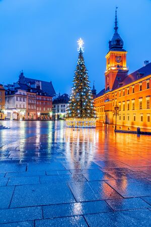 Warsaw, Poland - Christmas Tree in illuminated Castle Square, polish Old Town capital.