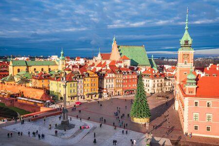 Warsaw, Poland - Christmas Tree in illuminated Castle Square with Column of Sigismund, polish capital.
