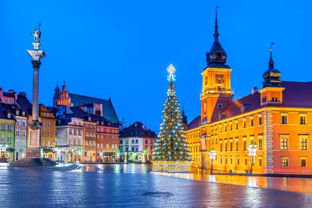 Warsaw, Poland - Christmas Tree in illuminated Castle Square with Column of Sigismund, polish capital.