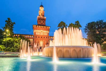 Milan, Italy - Sforza Castle (Castello Sforzesco) with beautiful fountain at night, built by Sforza, Duke of Milan. Tourist place at dusk.