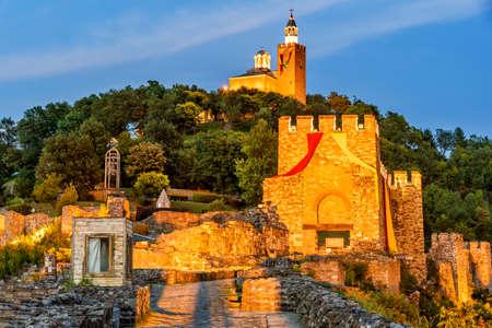 Veliko Tarnovo, Bulgaria. Tsarevets Fortress in in a beautiful summer blue hour light.