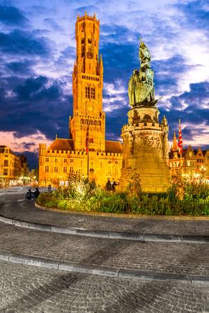 Bruges, Belgium. Grote Markt dominated by the Belfry or Belfort belltower,  West Flanders.