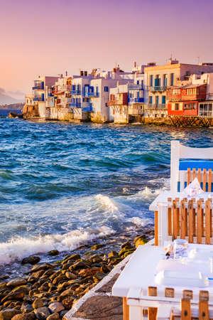 Mykonos, Greece. Colored sunrise of Litrtle Venice of Cyclades Islands on Aegean Sea.