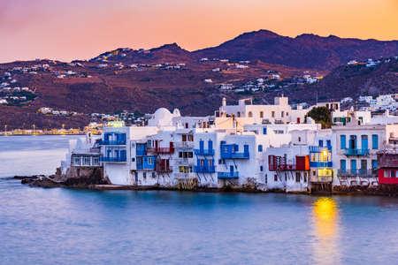 Mykonos, Greece. Colored sunrise of Little Venice of Cyclades Islands on Aegean Sea.