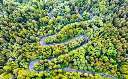 Sinaia, Romania and winding road in Bucegi Mountains, Carpathians