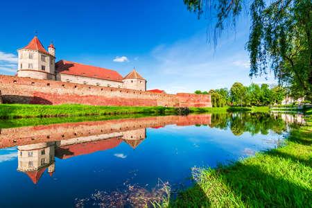 Fagaras, Romania. Stunning blossom landscape with medieval fortress in Transylvania.