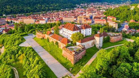 Brasov, Transylvania. Vivid sunrise aerial view from The Citadel, medieval fortress in Romania.