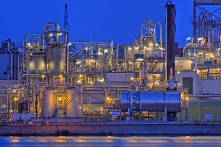 Chemical production facility on river bank Stock Photo